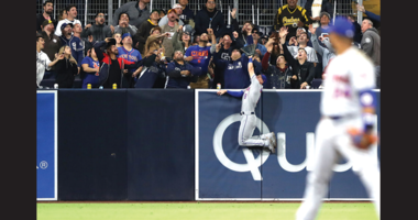 Jeff McNeil #6 of the New York Mets is unable to reach a solo homerun hit by Hunter Renfroe #10 of the San Diego Padres during the fifth inning of a game against the New York Mets at PETCO Park on May 06, 2019 in San Diego, California. (Photo by Sean M. H