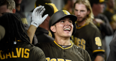 AUGUST 31: Luis Urias #9 of the San Diego Padres is congratulated after hitting a two-run home run during the eighth inning of a baseball game against the Colorado Rockies at PETCO Park on August 31, 2018 in San Diego, California. (Photo by Denis Poroy/Ge