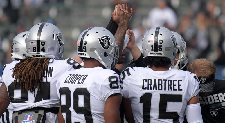 Raiders huddle before last game