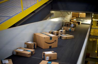 ROBBINSVILLE, NJ - AUGUST 1: Boxes travel on conveyor belts at the Amazon Fulfillment Center on August 1, 2017 in Robbinsville, New Jersey.