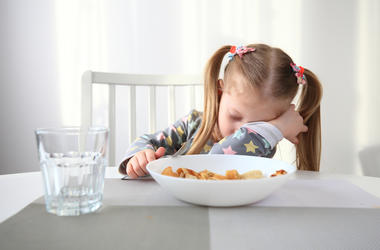 sleepy kid at breakfast