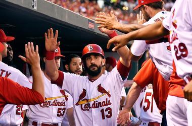 May 21, 2018; St. Louis, MO, USA; St. Louis Cardinals second baseman Matt Carpenter (13) is congratulated by teammates