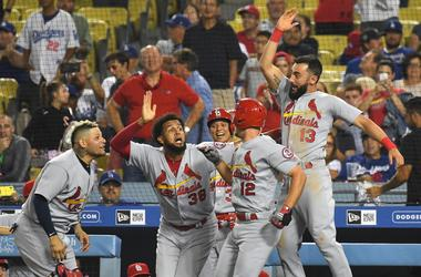 Aug 22, 2018; Los Angeles, CA, USA; St. Louis Cardinals shortstop Paul DeJong (12) celebrates with right fielder Jose Martinez (38) and first baseman Matt Carpenter (13) and catcher Yadier Molina (4) and shortstop Yairo Munoz (34)
