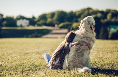 girl hugging large dog