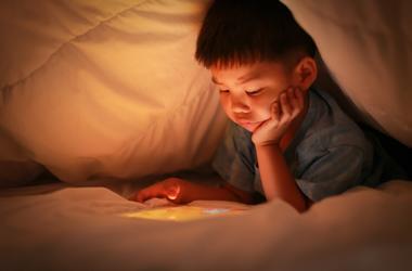 kid watching screen
