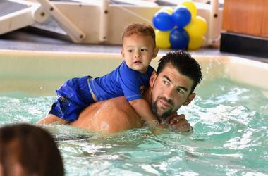 Michael Phelps swimming with baby