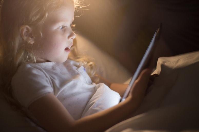 child looking at screen