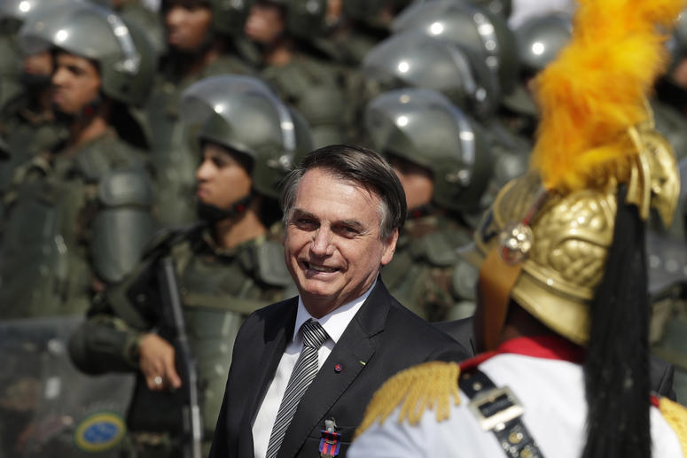 Brazils President Jair Bolsonaro arrive to attend a military ceremony for the Day of the Soldier, at Army Headquarters in Brasilia, Brazil, Friday, Aug. 23, 2019.