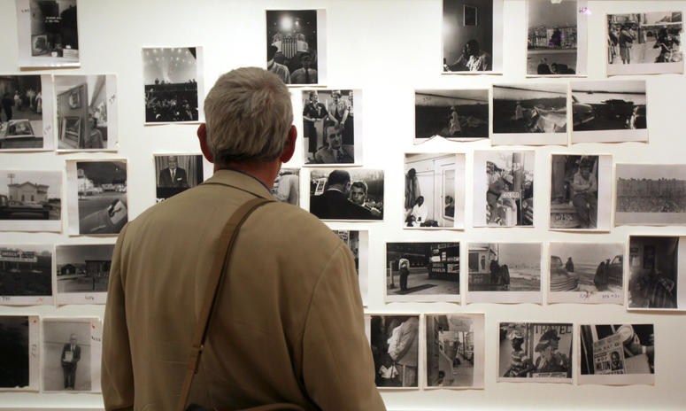 "A man looks at prints from the Looking In: Robert Frank's ""The Americans"" exhibit at the Museum of Modern Art in San Francisco."