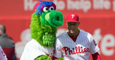 Apr 5, 2018; Philadelphia, PA, USA; Philadelphia Phillies manager Gabe Kapler (22) walks across the outfield with the Phillie Phanatic for opening day ceremonies before a game against the Miami Marlins at Citizens Bank Park.