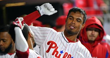 Apr 9, 2018; Philadelphia, PA, USA; Philadelphia Phillies right fielder Nick Williams (5) celebrates his home run with shortstop J.P. Crawford (2) during the eighth inning against the Cincinnati Reds at Citizens Bank Park.