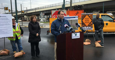 PennDOT District 6 Executive Ken McClain at the podium with Transportation Secretary Leslie Richards behind him.