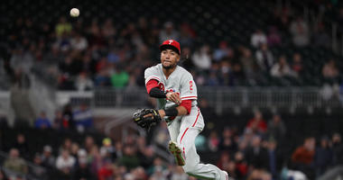 Mar 30, 2018; Atlanta, GA, USA; Philadelphia Phillies shortstop J.P. Crawford (2) throws to first base for the out of Atlanta Braves catcher Chris Stewart (not pictured) in the tenth inning at SunTrust Park.