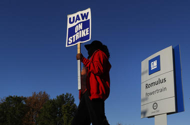 Yolanda Jacobs, a United Auto Workers member, walks the picket line at the General Motors Romulus Powertrain plant in Romulus, Mich.