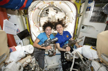 U.S. astronauts Jessica Meir, left, and Christina Koch pose for a photo in the International Space Station.