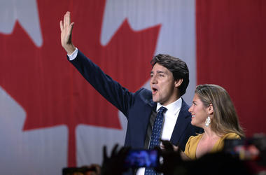 Liberal leader Justin Trudeau and wife Sophie Gregoire Trudeau wave as they go on stage at Liberal election headquarters in Montreal, Monday, Oct. 21, 2019.