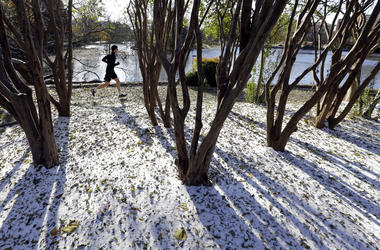 A jogger braves temperatures in the teens as he goes for a run Tuesday, Nov. 12, 2019, in Nashville, Tenn. Snow and icy conditions are snarling traffic and closing or delaying schools in parts of the Northeast and South.