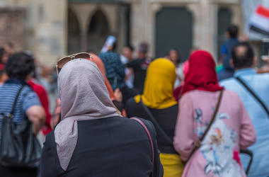 Women are shown wearing head scarves