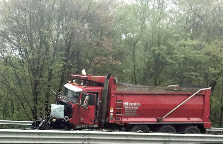 A dump truck sits near the scene after a collision with a school bus in Mount Olive, N.J.
