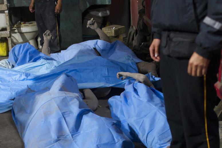 Bodies are laid in a temporary morgue near Volcan de Fuego, or Volcano of Fire, in Alotenango, Guatemala.
