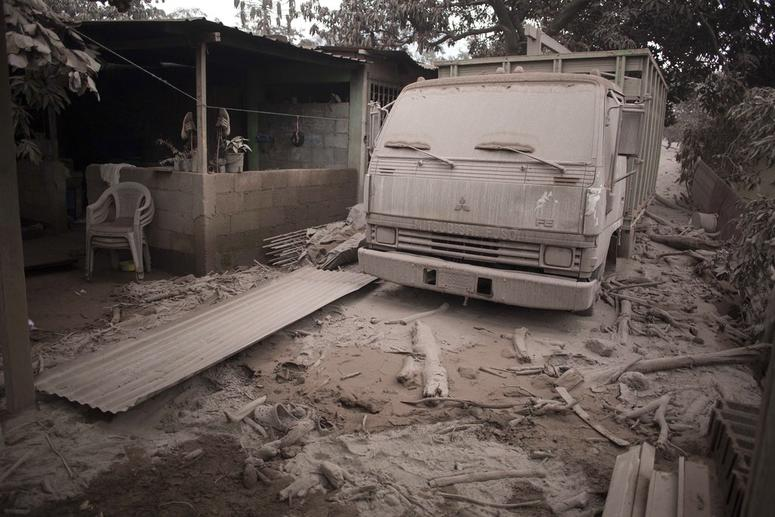 A truck is covered in volcanic ash spewed by Volcan de Fuego, or Volcano of Fire, in Escuintla, Guatemala.