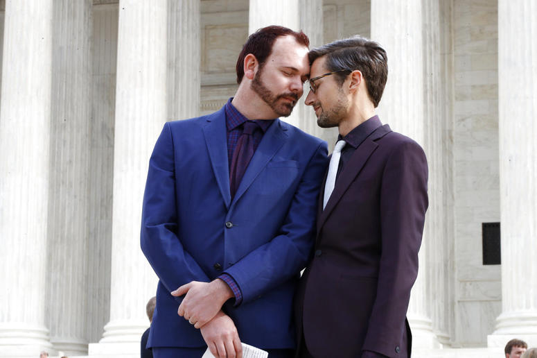 Charlie Craig, left, and David Mullins touch foreheads after leaving the Supreme Court in Washington in 2017. The Supreme Court is setting aside a Colorado court ruling against a baker who wouldn't make a wedding cake for the same-sex couple.