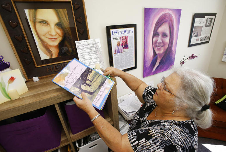 In this Monday, Aug. 6, 2018 photo, Susan Bro, mother of Heather Heyer, who was killed during the Unite the Right rally last year, looks over memorabilia in her office in Charlottesville, Va.