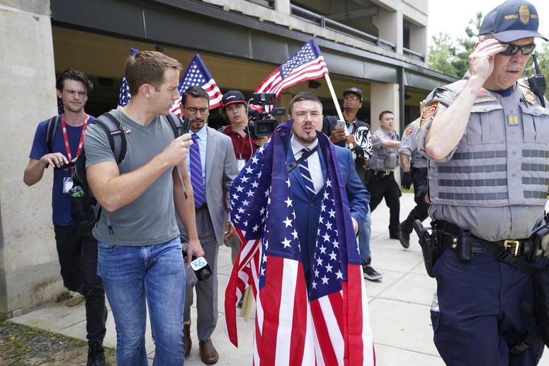 White nationalist Jason Kessler arrives at the Vienna metro station in Vienna, Va., Sunday, Aug. 12, 2018.