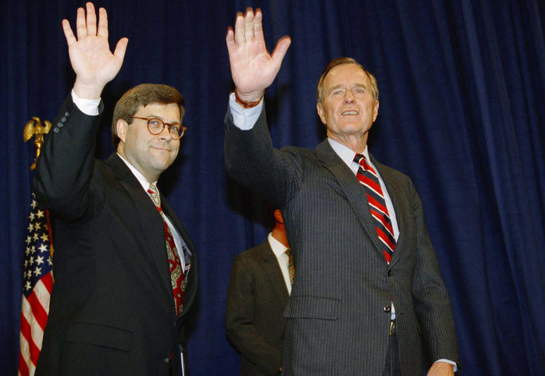 In this Nov. 26, 1991, file photo, President George H.W Bush, right, and William Barr wave after Barr was sworn in as the new Attorney General of the United States at a Justice Department ceremony in Washington.