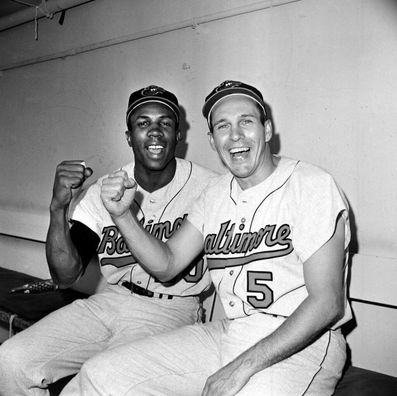 Frank Robinson (left) and Brooks Robinson, Oct. 5, 1966