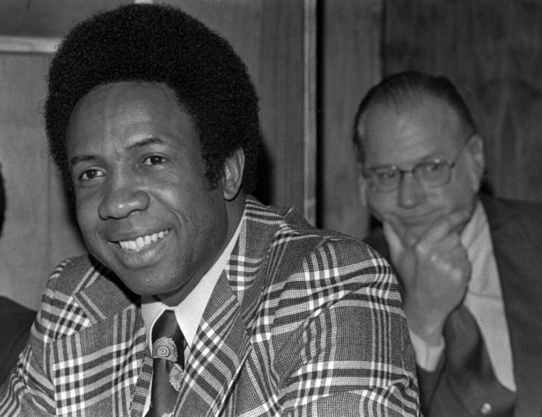 This June 19, 1996, file photo shows Frank Robinson at a news conference in Cleveland, Ohio, after being named Major League Baseball's first black manager, with the Cleveland Indians.