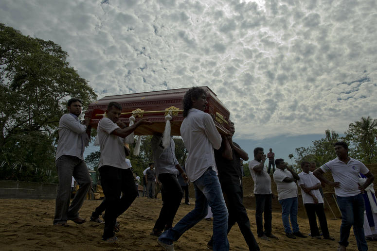 A mass burial for victims in Sri Lanka.