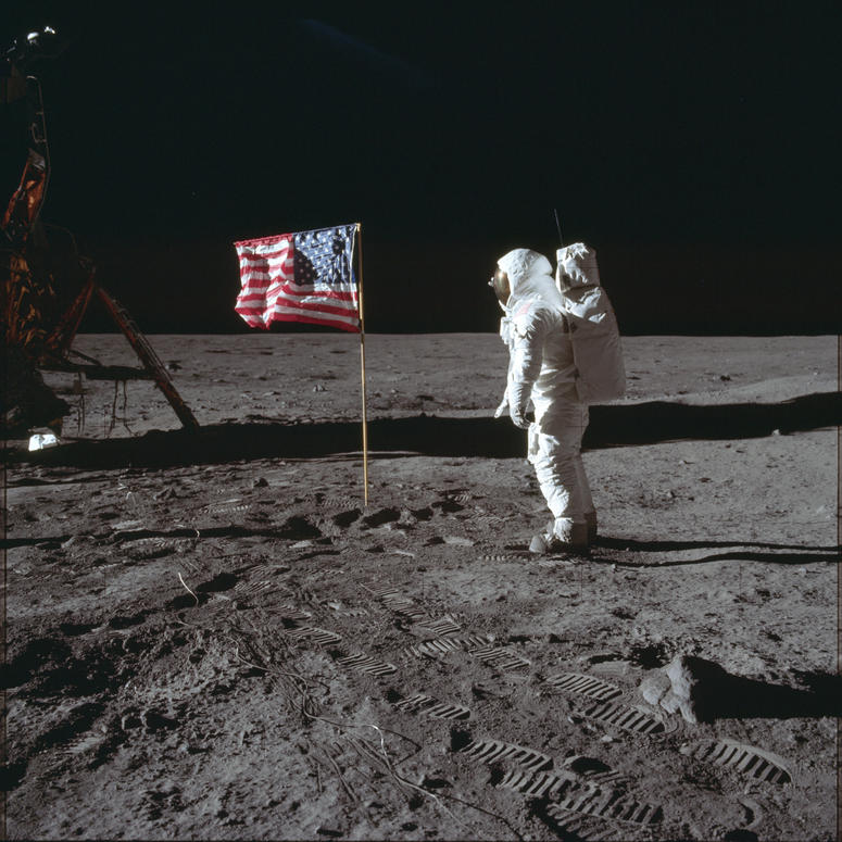 In this July 20, 1969 photo made available by NASA, astronaut Buzz Aldrin Jr. poses for a photograph beside the U.S. flag on the moon during the Apollo 11 mission.