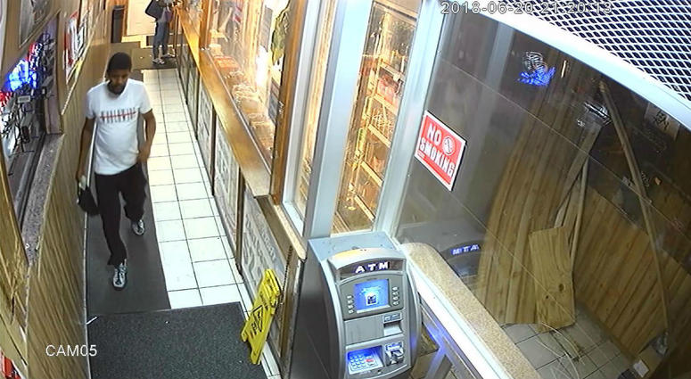This image, taken from surveillance video, shows one of at least two men Philadelphia police are looking for in connection to an ATM explosion in Kensington Wednesday night.