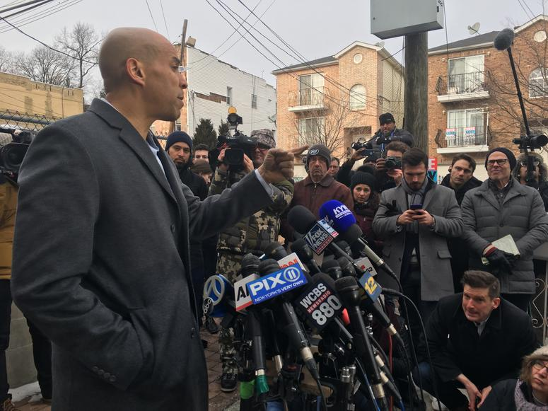 Sen. Cory Booker met with reporters outside his Newark home to discuss his presidential bid.