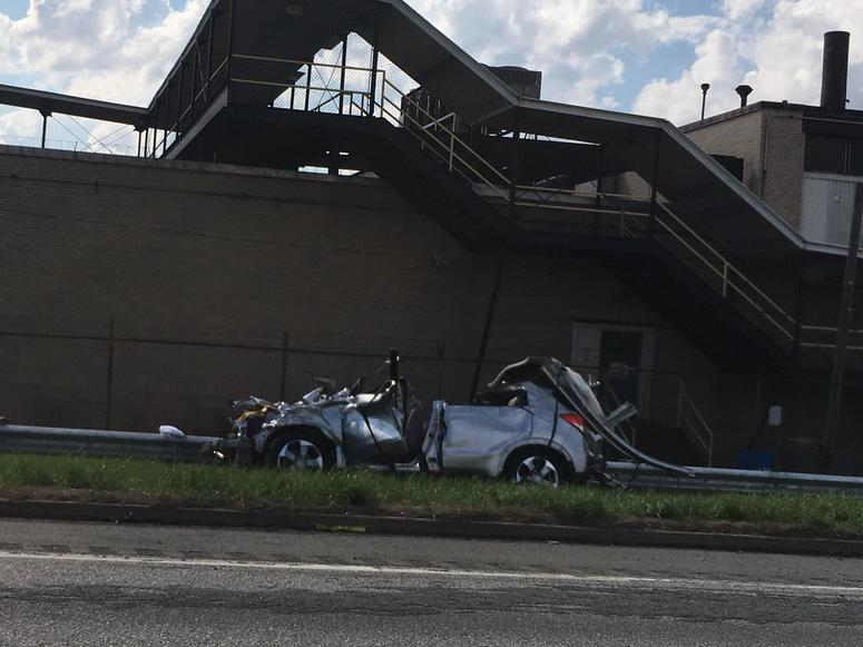 Officials: Overturned tractor-trailer accident leaves 1 dead