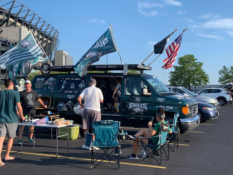 Tom Gearhart and his family tailgate before the first Eagles home preseason game.