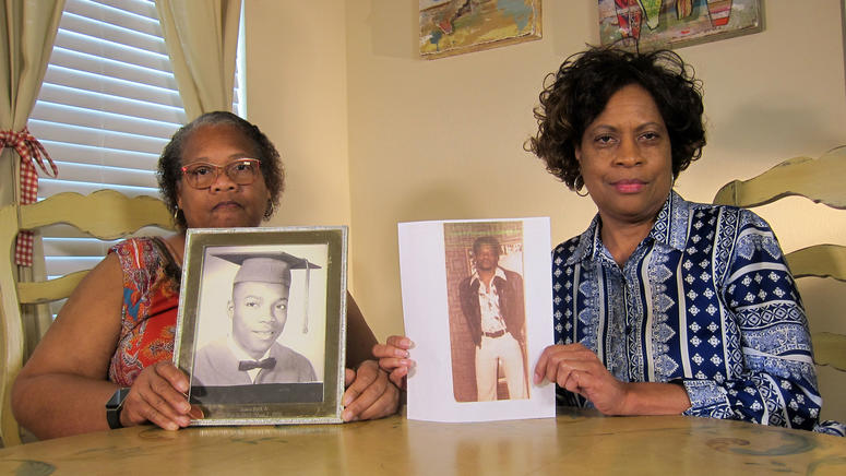 In this Wednesday, April 10, 2019, photo Mylinda Byrd Washington, 66, left, and Louvon Byrd Harris, 61, hold up photographs of their brother James Byrd Jr. in Houston.