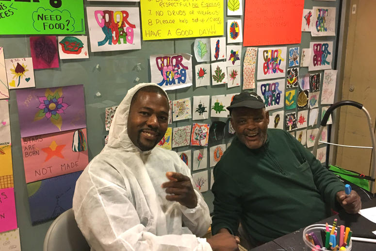 """Kevin Davis and Milton """"PD"""" Brown participate in the Mural Arts same-day pay program."""