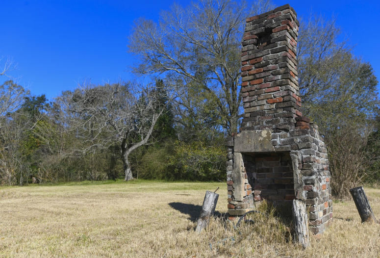 A chimney, the last remaining original structure from the days when survivors of the Clotilda, the last known slave ship brought into the United States, inhabited the area, stands in an abandoned lot in Africatown in Mobile, Ala.