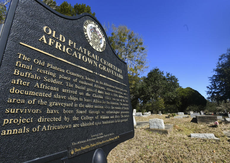 Old Plateau Cemetery, the final resting place for many who spent their lives in Africatown, stands in need of upkeep near Mobile, Ala., on Tuesday, Jan. 29, 2019. Many of the survivors of the Clotilda's voyage are buried here amongst the trees.