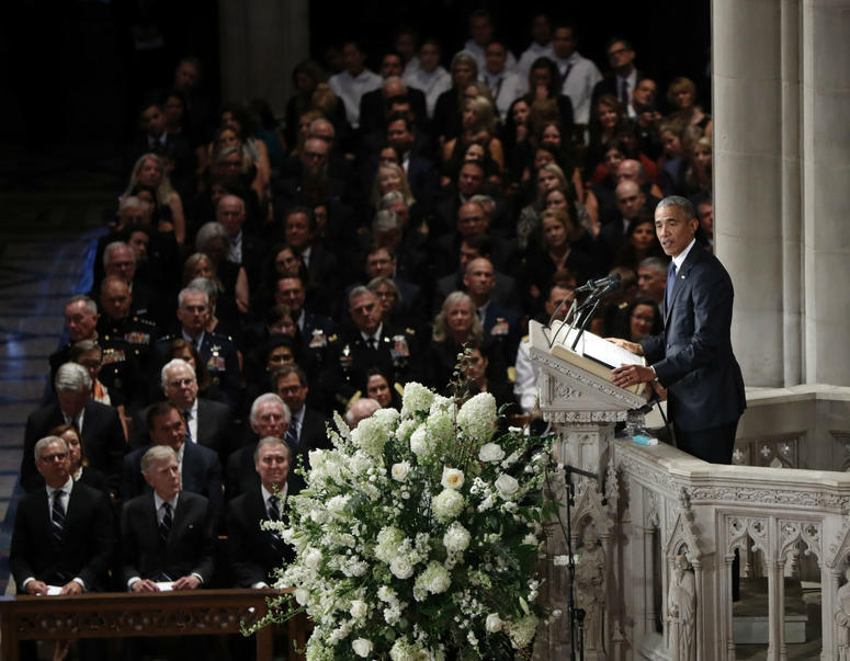 Former President Barack Obama pauses as he speaks at a memorial service for Sen. John McCain, R-Ariz., at Washington National Cathedral in Washington, Saturday, Sept. 1, 2018.