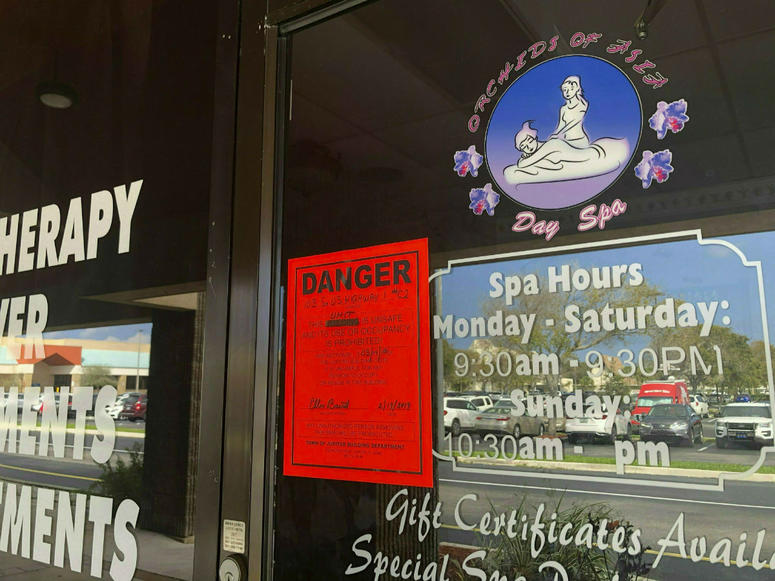 In this Feb. 19, 2019, file photo, a sign is posted outside of Orchids of Asia Day Spa in Jupiter, Fla., one of several spas closed in south Florida as a result of a six-month investigation into sex trafficking.