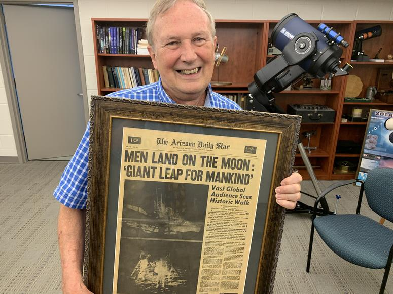 Villanova astronomy and astrophysics professor Dr. Edward Guinan holds a historic front page reporting on the Apollo 11 moon landing.