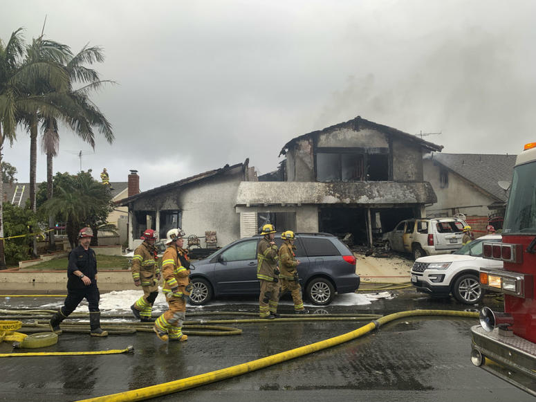 Firefighters respond to the scene of a plane crash at a home in Yorba Linda, Calif., Sunday, Feb. 3, 2019.