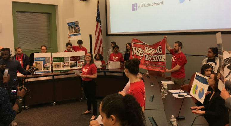 Activists opposed to the policy then disrupted Friday night's meeting as a divided school board has approved a policy requiring all district high schools to use walk-through metal detectors.