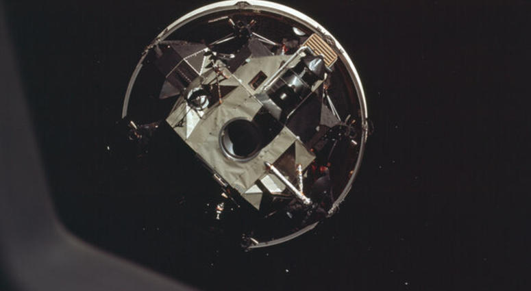 The Apollo 11 crew docks head-first with the moon landing module.