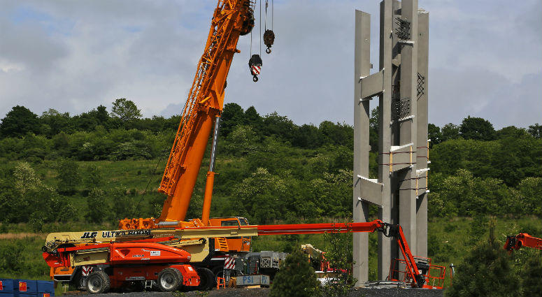 first section of the 93-foot tall Tower of Voices wind chimes is in place at the Flight 93 National Memorial in Shanksville, Pa.