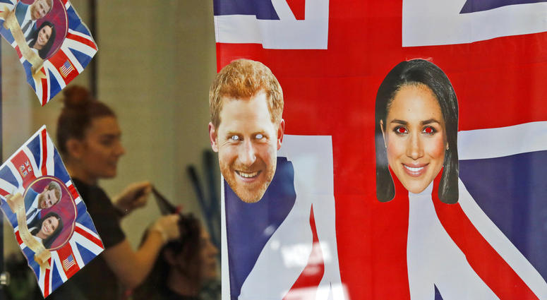 A window is decorated with flags and pictures of Britain's Prince Harry and Meghan Markle in Windsor.