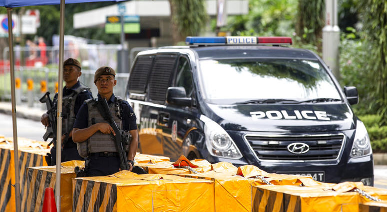 Gurkha police officers stand guard outside the St. Regis Hotel in Singapore, Sunday, June 10, 2018, ahead of the summit between U.S. President Donald Trump and North Korean leader Kim Jong Un.